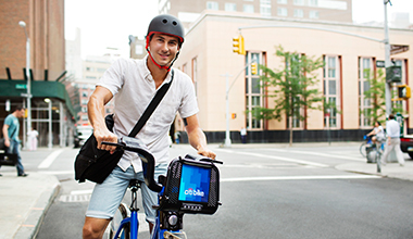 Guy in Helmet Riding Citi Bike