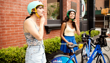 2 Girls Putting on Helmets